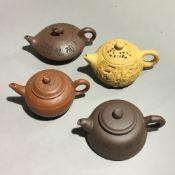 Four Yixing teapots