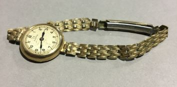 A lady's gold cased Omega wristwatch
