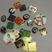 A quantity of Nazi badges