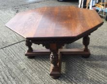 A large Victorian carved oak centre table