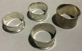 Four silver napkin rings