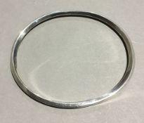 A silver bangle (20.