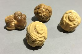 Four carved netsuke
