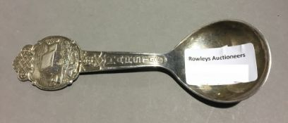 A white metal Scandinavian caddy spoon