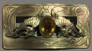 An Art Nouveau stone set brooch