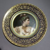 A 19th century painted porcelain Vienna plate