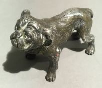 A small silver model of a bulldog