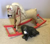 A small fabric covered rocking horse and a plaster black spaniel