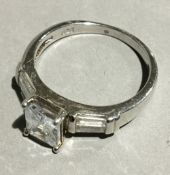 A silver and cubic zirconia ring
