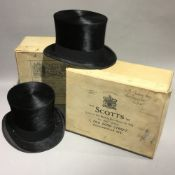 Two boxed top hats