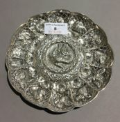 An embossed unmarked Eastern silver dish (approx 3.