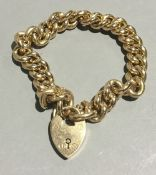 An Edwardian 15 ct rose gold bracelet, with heart shaped locket (approximately 28.