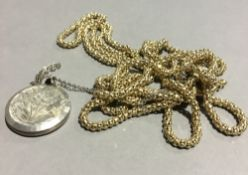 A silver gilt necklace and pendant locket (24.