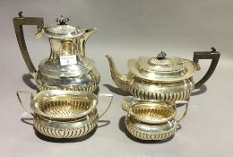 A silver four piece tea set (approx 43 troy ozs)