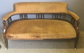 A Victorian inlaid rosewood framed salon settee