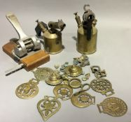 A quantity of horse brasses and blow lamps