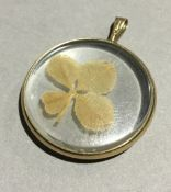 A 9 ct gold mounted four leaf clover pendant