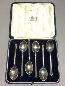 A cased set of enamel decorated silver teaspoons (approx 2 troy ozs)