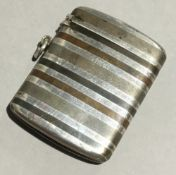 A silver and mix metal vesta