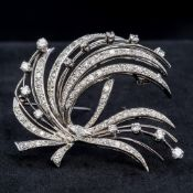 An 18 ct white gold diamond set brooch Of spray form, set with approximately 3 carats of diamonds.