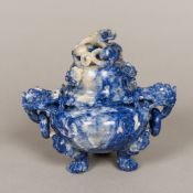 A Chinese carved lapiz lazuli censer The domed removable top carved with a dragon,