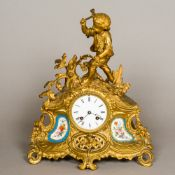 A 19th century painted porcelain mounted gilt metal mantle clock The white enamelled dial with