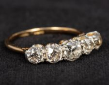 An 18 ct gold and platinum five stone diamond ring The central stone approximately 0.4 carat.
