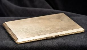 A 9 ct gold cigarette case Of hinged chamfered rectangular form, with engine turned engraving,
