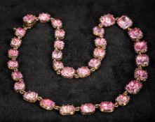 A Georgian unmarked gold pink topaz set necklace 36 cm long.