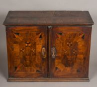 An 18th century marquetry and parquetry inlaid walnut table cabinet The parquetry inlaid