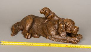A large 19th century Black Forest carved wooden animalier group Formed as a Labrador Retriever and