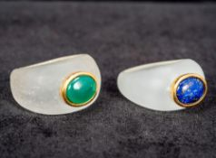 A lapis lazuli and gold set ring Together with a similar jade set ring. The former 1.2 cm high.
