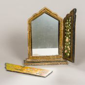 A 19th century Persian painted papier mache framed dressing mirror Of triptych form,