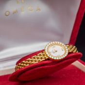 A diamond set 18 ct gold Omega lady's wristwatch The diamond set dial inscribed Omega Swiss Made,