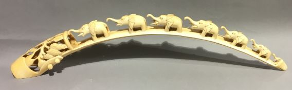 An early 20th century carved tusk Worked with a train of elephants. 70 cm long.