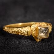 An early, possibly Medieval, unmarked gold stone set ring Of heart form, with half engraved shank.
