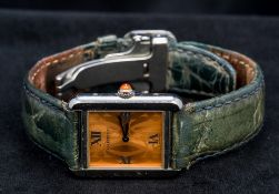 A Cartier stainless steel cased gentleman's Tank wristwatch Of typical rectangular form. 2.