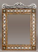 A Turkish tortoiseshell and mother-of-pearl inlaid wall glass The serpentine mother-of-pearl inlaid