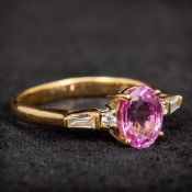 An 18 ct gold diamond and pink stone ring 7mm high.