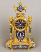 A 19th century French cloisonne decorated ormolu mantel clock The fruiting twin handled urn above a