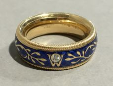 An 18 ct gold and cold enamelled Wellendorff spinning ring,