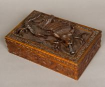 A late 19th century Eastern carved wooden box Of rectangular hinged form,