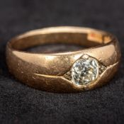 An 18 ct gold diamond solitaire ring The gypsy set stone spreading to approximately 0.75 carat.