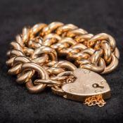 An Edwardian 9 ct gold bracelet With heart shaped locket.