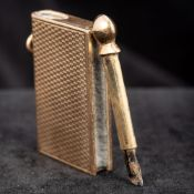 A George V 9 ct gold novelty fob striker by Asprey Modelled as a book. 5 cm long overall.