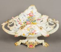 A large 19th century Le Nove faience pottery centre piece Of scrolling leaf form,