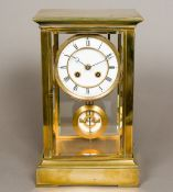 A 19th century lacquered brass cased four glass mantel clock The white enamelled dial with Roman
