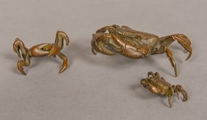 A set of three Japanese patinated bronze crabs Each naturalistically modelled,