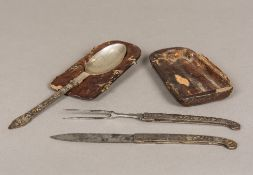 An 18th century German silver mounted gilt heightened polished steel travelling cutlery