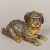 A 19th century French cold painted bronze inkwell Formed as a recumbent puppy with hinged neck.